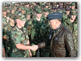 General shaking hands of soldiers