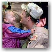 Child hugging American Veteran